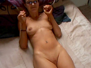 A sandy-haired nymph in glasses rails a penis and masturbates