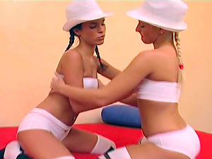 Ponytailed lesbos Jordan and Leah make out and plaything each other's vags