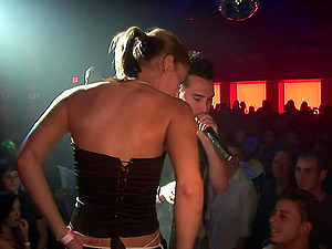 A few sexy chicks flash their tits and butts in a club