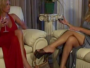 Lesbo cougar with big faux tits getting her vagina tongued on her sofa