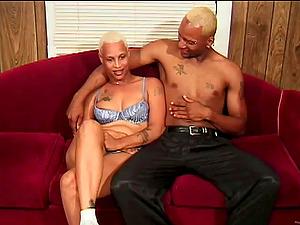Manlike black cockslut Lisa lets a stud fuck her hairless vulva