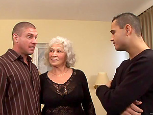 Two Hot Sexy Dudes Fuck A Horny Grannma On The Sofa