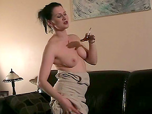 Dark-haired mummy Mina smokes invitingly and thumbs her twat