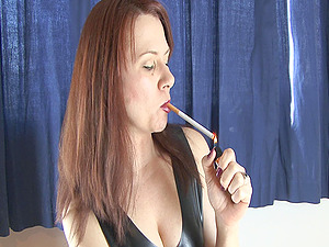 Cougar smoking in leather and gives provocative unwrap taunt
