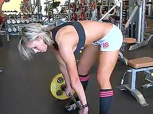 Well-shaped sexy stunner with big bobs is exersising in the gym and maturbates