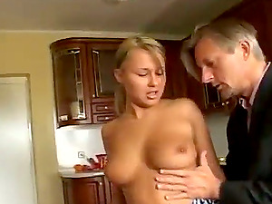 Two lovely blondes suck a hard-on and get fucked doggystyle in FFM flick