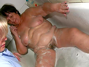 Two fat mature lesbos finger and plaything each other's meaty cunts