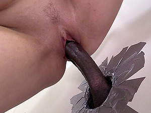 Alice Frost welcomes a gloryhole Big black cock in her cunt and mouth