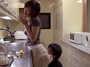 Sexy Japanese honey with brief hair sucking her beau's big manstick in her kitchen