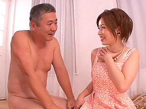 Japanese female dom as she ties up her man before providing him a handjob