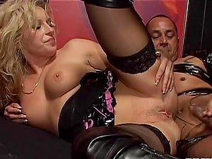 Accepting cougar with natural tits in undergarments providing big dick handjob in threesome fuck-a-thon