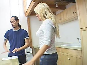 Attractive foot worship cougar in jeans getting erotic with her gent in the kitchen