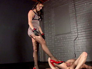 Chubby honey in a sexy undergarments delivering a ball busting torment to a dude in restrain bondage