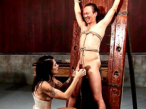 Adorable female domination crucifying a dude then administering a ball busting torment in a Sadism & masochism