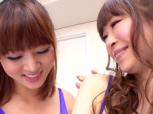 Japanese femmes in swimsuits have lesbo strapon hookup