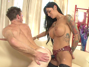 Tattooed Cougar with gigantic faux tits peggs her gimp with a strapon
