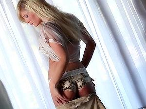 Lovely blonde Tasha Reign frigs her labia on the sofa
