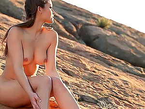 Sexy honey Dani Daniels frigs her vulva in the mountains