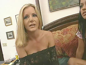 Pretty girl-on-girl cougar with giant tits getting her pierced cunt frigged