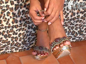 An Italian stunner punches back and touches her very sexy feet