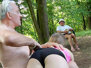 An old stud spanks a blonde then pulls her hair while fucking her