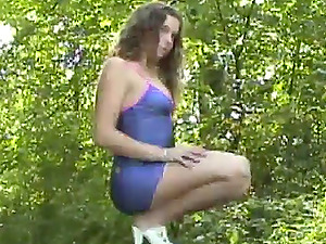 Lengthy haired broad in a brief microskirt loving an outdoors solo shoot