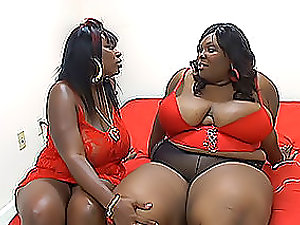 Two very fat dark-hued lezzies have fun dirty games on the couch