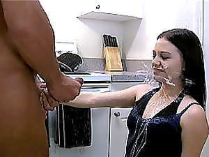Sexy youthful chick gets her face covered with jizm in the kitchen