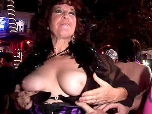 Big jugged cougars at Mardi Gras take out their sexy tits