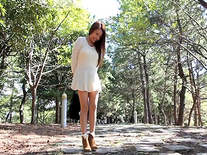 Long legged Asian chick with large tits sucking a stranger's hard-on