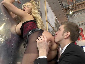 Glamour dame in a corset and pantyhose fucked up the arse