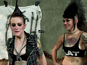 Tattooed girl/girl punk bitches using strapons on each other