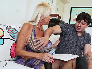 Blonde granny in stockings violates a sweat on a junior stud's hard-on gonzo