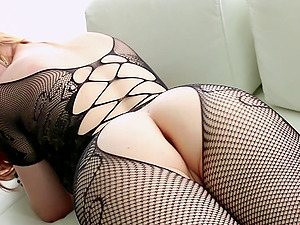 Alluring sandy-haired woman in bodystockings masturbating and fucking