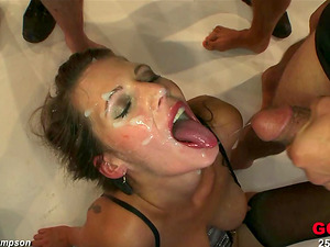 Viktoria lets a few guys spunk in her mouth at the same time