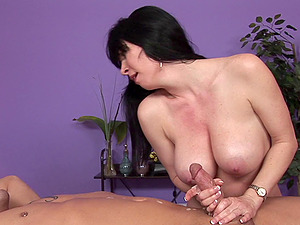 During the rubdown she sits on his face and strokes him off