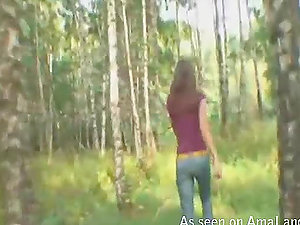 Skinny brown-haired nubile deepthroats dick in the forest