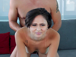 Enticing dark haired female deep throats a dick like a pro