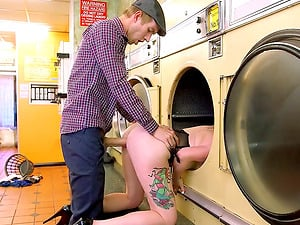 On laundry day she gets fucked in the middle of the laundromat