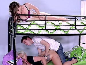 Her sexy roomie hops in and they have a threesome in the dormitory