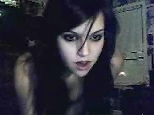 Nubile black-haired honey performs striptease display via webcam