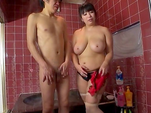 Chubby Asian woman washes and strokes a fellow in the bathtub
