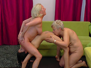Nubile beauty gives to mature honeys a lap dance then licks their slits