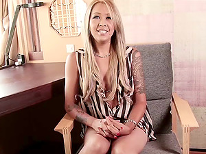 Sassy blonde transsexual in sexy mini micro-skirt posing invitingly