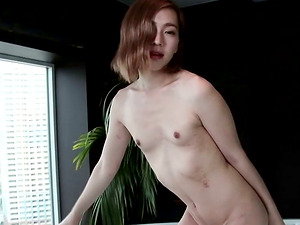 Sexy transsexual ecstatic as she hold her stiff man rod in the bathtub