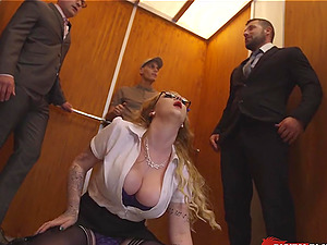 Threesome in an elevator with this big tits assistant
