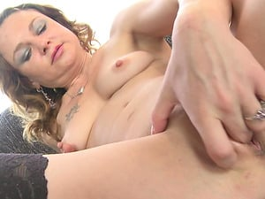 Petite Cougar works her taut cunt with a few different fucktoys