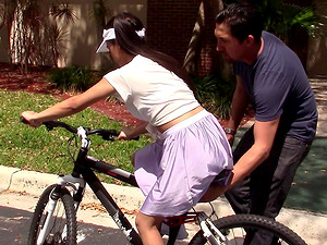 He instructs her to rail a bike then to rail his fat penis