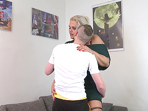 Slender dude fucks the curvy blonde chick in stockings