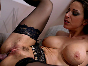 Stockings and garter belt beauty sated by a black dick